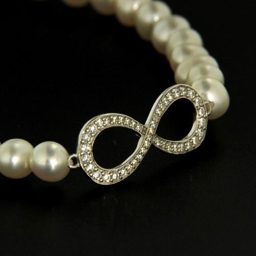 Süßwasser-Perlenarmband (5,5 mm) 18 cm elastisch mit Zwischenteil Silber 925 rhodiniert unendlich